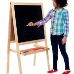 School girl writing on blackboard — Stock Photo #49223861