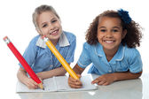 School girls doing homework together — Stock Photo