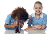 Kids using microscope in lab — Stok fotoğraf
