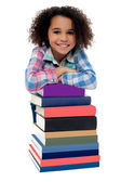 Girl with stack of textbooks — Stock Photo