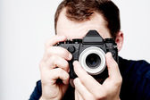 Man taking photo with professional camera — Stock Photo