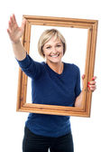 Woman with picture frame — 图库照片