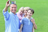 Father taking family picture — Stock Photo