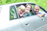 Father enjoying car drive with kids — Stock Photo