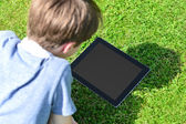 Boy looking at tablet screen — Stock Photo
