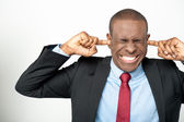 Businessman closing ear by his hands — Photo