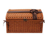 Wicker chest with ribbon — Stock Photo
