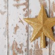 Gold shiny christmas star  — Stock Photo