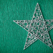 Silver colored metal christmas star — Stock Photo #34159213
