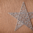 Silver colored metal christmas star — Foto Stock