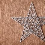 Silver colored metal christmas star — Stockfoto