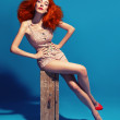 Stock Photo: Red haired lady in retro swimsuit