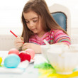 Girl making colorful eggs for easter — Stock Photo