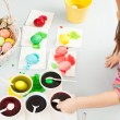 Girl making easter eggs — Stock Photo