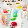 Stock Photo: Girl colorig easter eggs