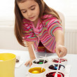 Girl coloring eggs — Stock Photo