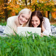 Stock Photo: Girls study in autumn park