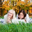 Girls study in autumn park — Stock Photo #13650480