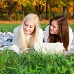 Girls study in autumn park — Stock Photo #13650508