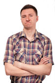 Man in a plaid shirt with funny face expressions — Stock Photo