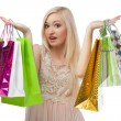 Woman can not choose what to buy — Stock Photo #35348227