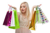 Woman can not choose what to buy — Stock Photo