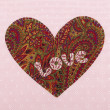 Handmade fabric heart with the word love — Stock Photo