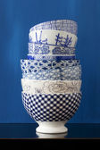 Stack of bowls with blue and white designs — Stock Photo