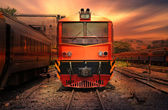 Train passing by in orange sunset — Fotografia Stock