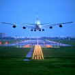 Passenger plane fly up over take-off runway from airport — Stock Photo