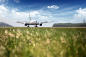 Airplane at takeoff — Stock Photo