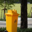 Trash can yellow in park — Stock Photo