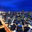 View over city of bangkok at nighttime with skyscrapers — Stock Photo #19448423