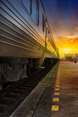 Train passing by in orange sunset — Stock Photo