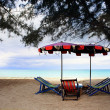 Beach chairs with umbrella - Stock Photo