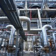 Stock Photo: Pipes, tubes, machinery and steam turbine at power plant