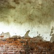 The destruction of a brick wall  background — Stockfoto