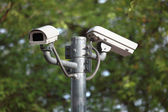 White CCTV camera watching for security 24 hours — Stock Photo