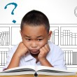 Stock Photo: Young boy tired of reading