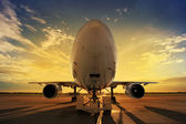 Airplane at sunset - back lit — Stock Photo