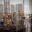 Stock Photo: Building under construction with workers