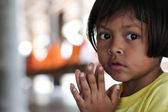 Portrait of a pretty 8 year old Filipina girl in poverty-stricken neighborhood, natural light. — Stock Photo