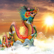 Chinese dragon at sunset in the background — Stock Photo