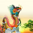 Stock Photo: Chinese dragon at sunset in background