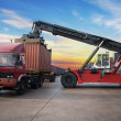 Stack of Freight Containers at the Docks with Truck — Stock Photo