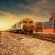 Stock Photo: Cargo train platform at sunset with container