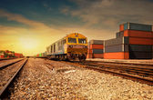 Cargo train platform at sunset with container — Stock Photo