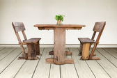 Old wood chair and wood table — Stock Photo