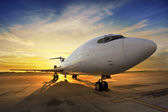 Business plane at sunset - back lit — Stock Photo