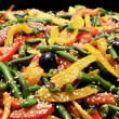 Green beans, peppers, olives with sesame seeds — Stock Photo